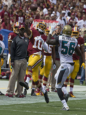 Robert Griffin III injures his ankle after throwing for a first down against the Jacksonville Jaguars.