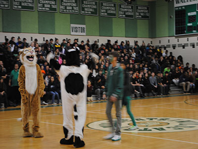 The SGA president and vice president work with the mascots to get everyone pumped for the pep rally.