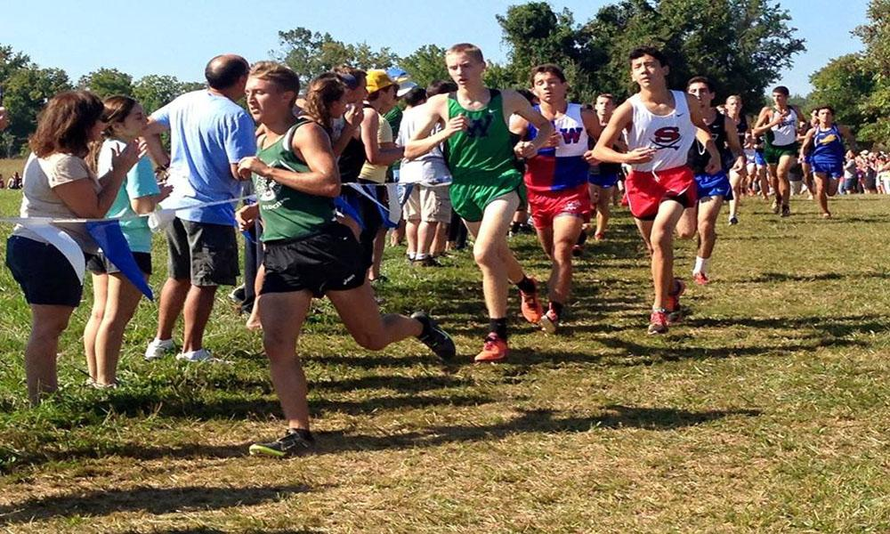 Senior runner Carter May leads the pack in an earlier meet.