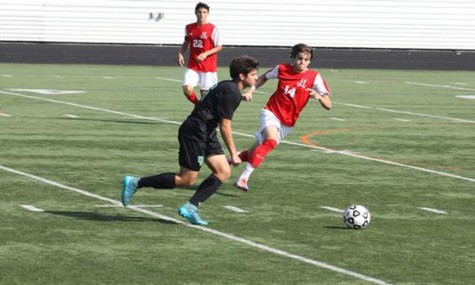 Senior captain Zach Labonski looks to pass in the game.