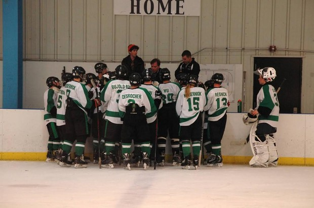 The team huddles together to discuss strategy. Photo credit of Brando Kobernick