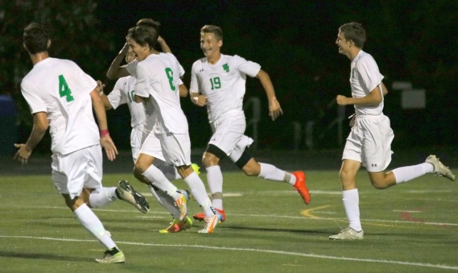 Players+on+the+boys%27+soccer+team+congratulate+each+after+scoring+a+goal+in+a+3-1+win+against+Bethesda-Chevy+Chase+High+School+on+September+13.+Photo+courtesy+of+WJ+Athletics.