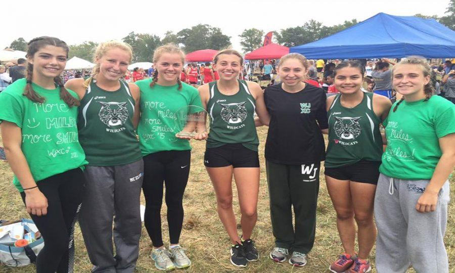 WJ girls cross country, the reigning state champions, are seen here after winning a race at an invitational meet earlier this year.