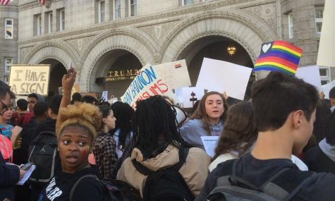 The protesters congregate around the newly opened Trump Hotel at the beginning of the march. From there, they went on to march across most of DC. Photo by Yael Hanadari-Levy.