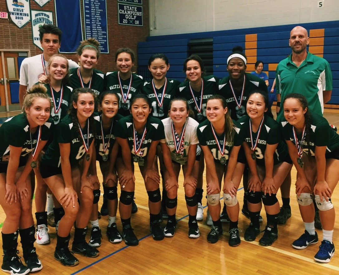 (Girls Volleyball posing with their medals after finishing second place after the Tournament at Churchill.)