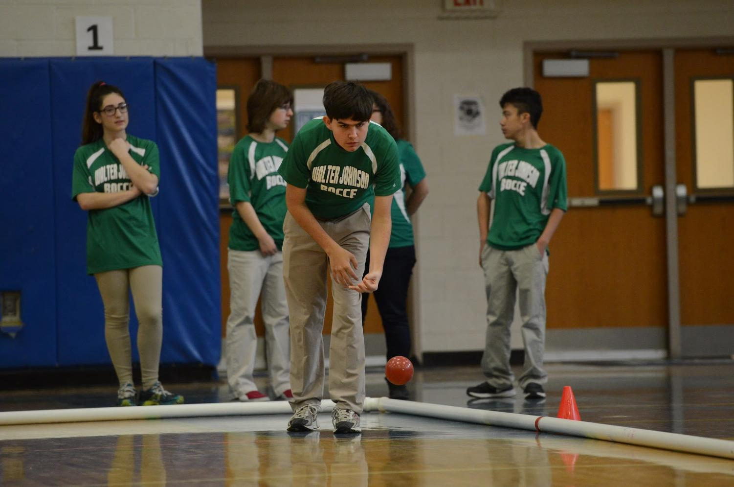 Junior Justin Zimmer pitches the bocce ball. Photo courtesy of Lifetouch.
