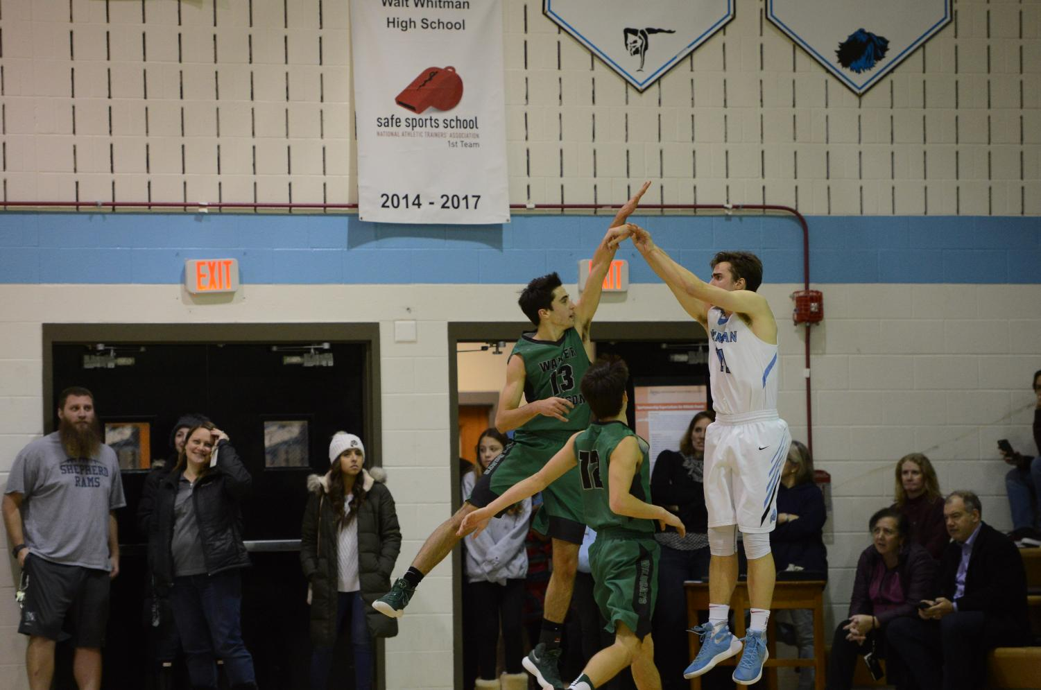 Senior captains William Koenick and Nick Bournias jump to block their opponent's shot. Koenick and Bournias have been leading scorers for the team throughout the season.