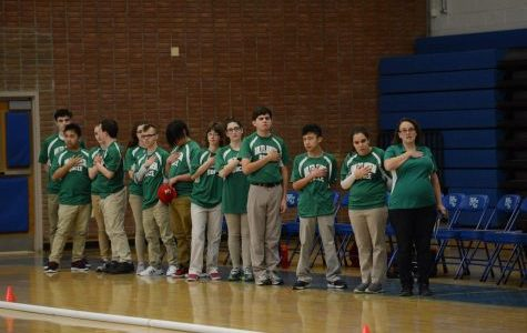 The Bocce team says the pledge before the game against Churchill. Image Courtesy of Lifetouch