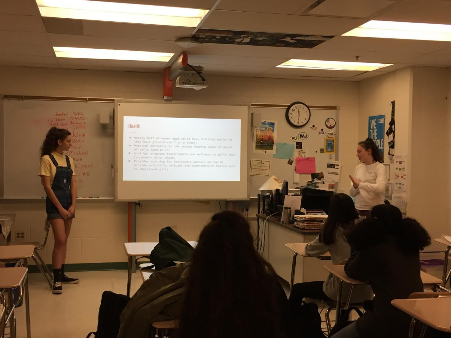 Girl Up members junior Emma Jean Thomas and sophomore Mallory Laing educate others on the importance of girls education.