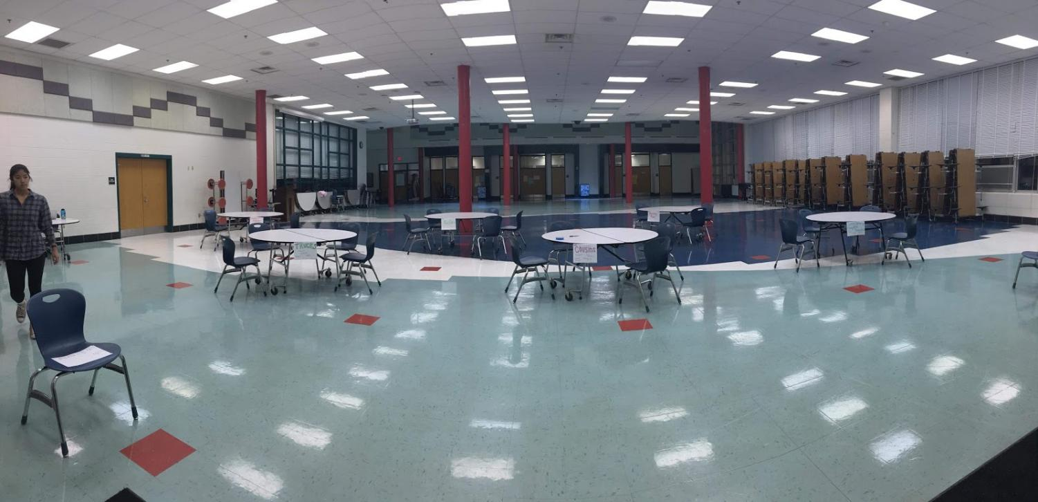 Senior Jessica Lee sets up the tables prior to the first ever WJ Puzzle Tournament. The tournament was held on December 15. Picture courtesy of Jessica Lee.