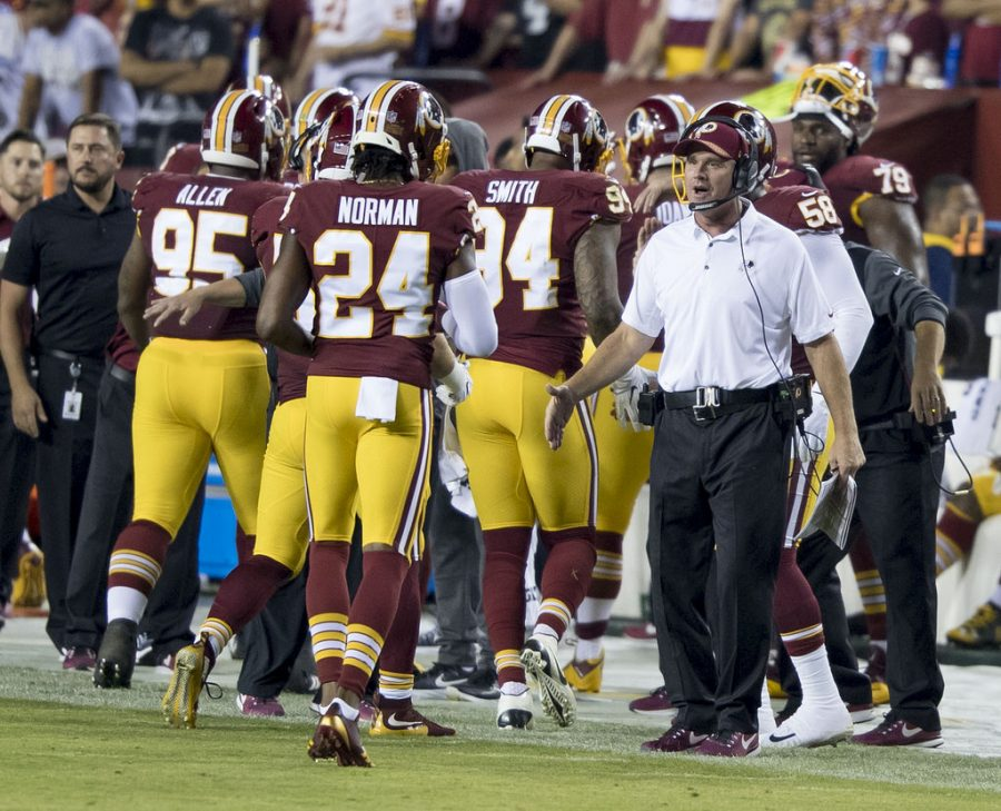 Washington+Redskins+players+walk+off+the+field+after+the+game+against+the+Oakland+Raiders.+The+Redskins+ended+their+season+after+a+loss+to+the+New+York+Giants.