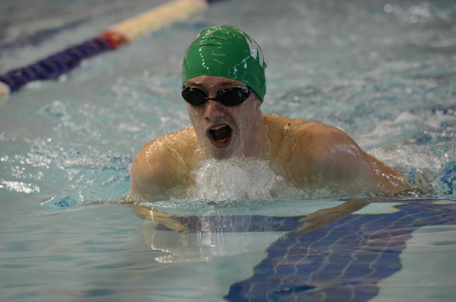 Junior Timmy Ellett swims breaststroke during a meet. Ellett's strong swimming is one of the reasons the boys have performed so well after last year's disappointing season. Photo courtesy of Lifetouch Studios