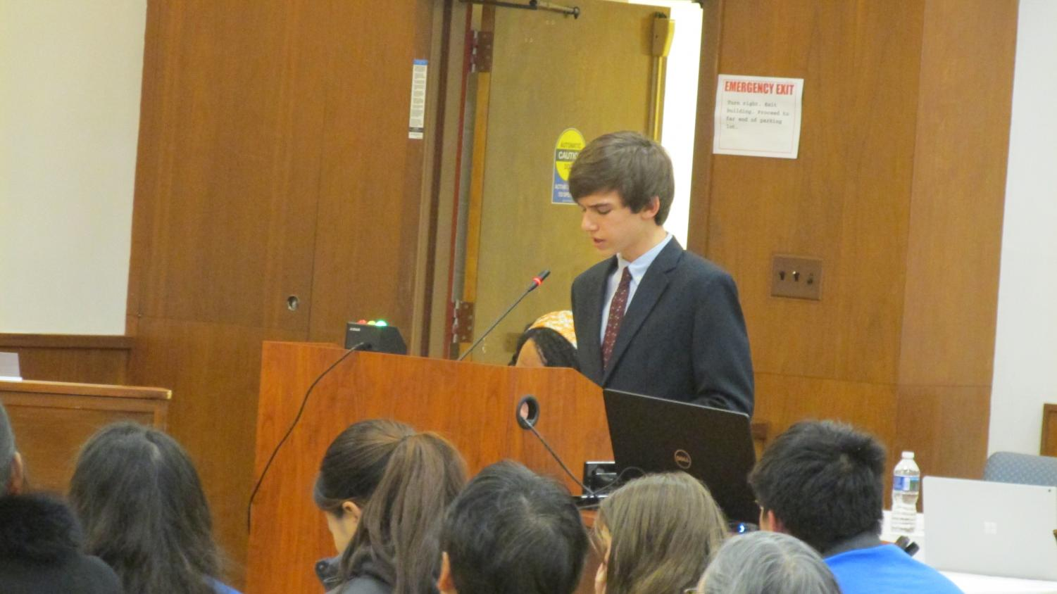 WJ junior SMOB candidate Drew Skilton presents himself in front of the panel of representatives for the MCPS Board of Education. He spoke alongside WJ representative James Bradley in an effort to change the current regulations surrounding counselor relationships with the students and their perspective schools. Photo by Jack Linde.