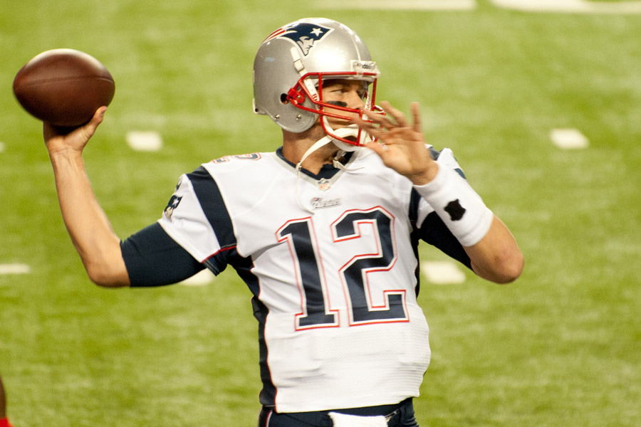Brady looks down the field to throw a pass.  The Patriots pulled off a miraculous win in last year's Super Bowl, as they came back from a 28-3 deficit.