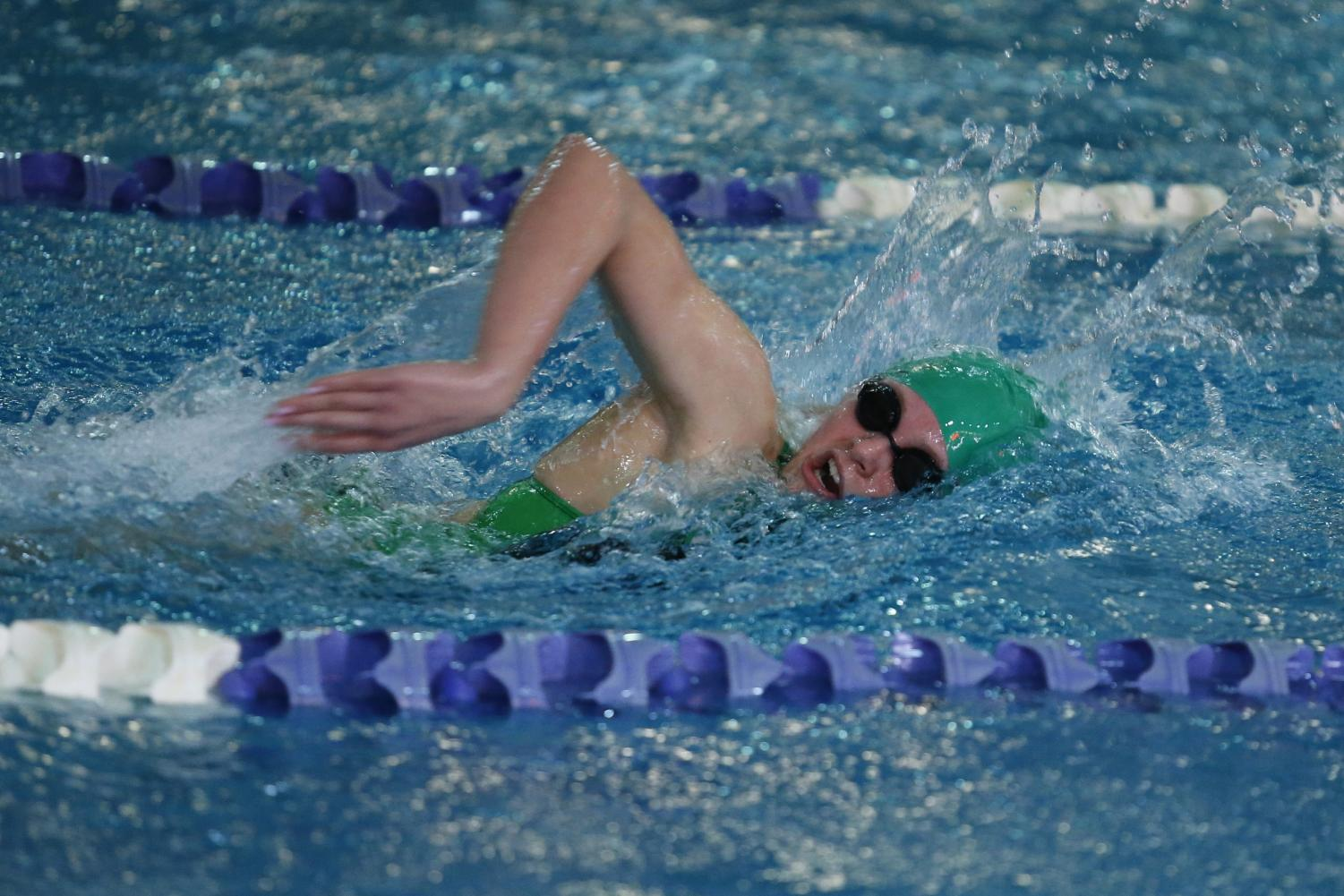Sophomore Molly Benson takes a breath during the freestyle. Photo courtesy of Lifetouch Studios
