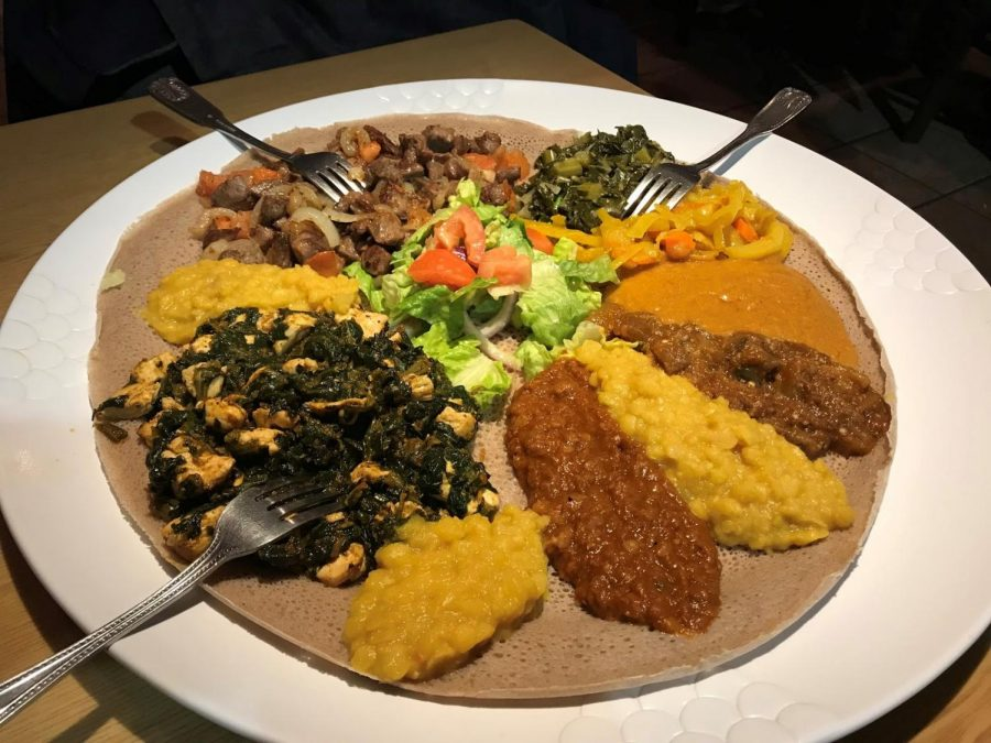 The traditional Ethiopian cuisine consists of selection of meats, vegetales and dips served on a traditional Ethiopian bread. Photo by Rafael Friedlander