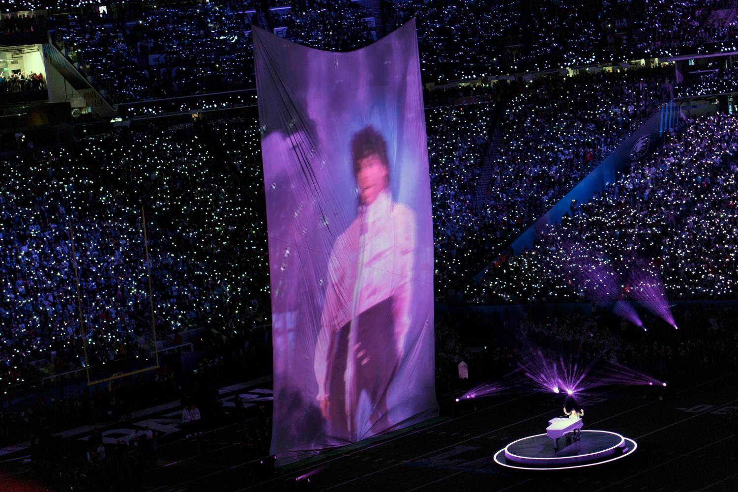 A giant projection of Prince accompanies Timberlake as he sings