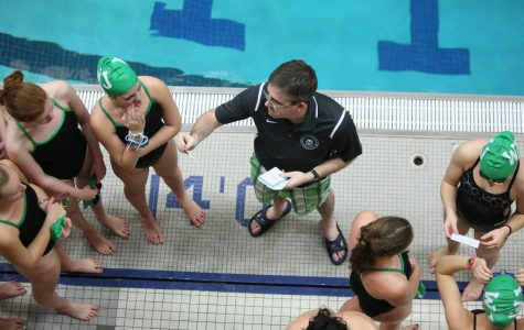 Coach Jamie Grimes instructs his racers during a meet.  Coach Grimes led WJSD to another successful season this winter. Photo courtesy of Lifetouch Studios