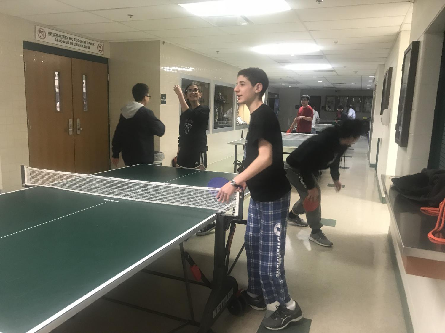 Ping-Pong games with Mr. Choi. Photo by Sam Falb.