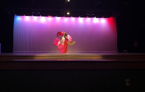 A traditional fan dance is performed to kick off the Asian Heritage Assembly.
