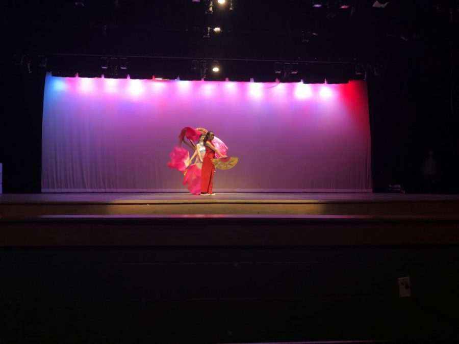 A+traditional+fan+dance+is+performed+to+kick+off+the+Asian+Heritage+Assembly.+