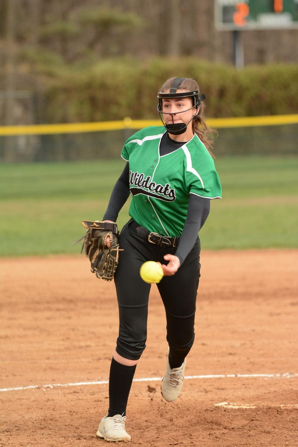 Senior captain Jessica Kaplan tosses the ball to one of her teammates. Softball finished with a 3-7 record this season. Photo courtesy of Lifetouch Studios.