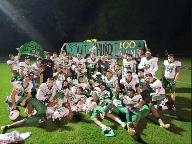Walter Johnson football celebrates Coach Larry Hurd Jr.'s career win 100, with a win over Springbrook High School, by a score of 50-10. The Wildcats look to continue their early season success against Richard Montgomery this Friday. Photo courtesy of WJ Athletics.