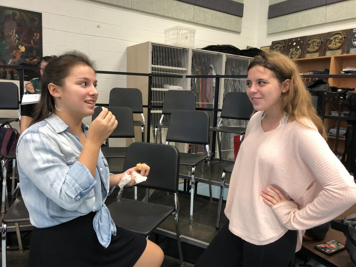 Junior Angie Ciccarello and senior Maddie Osterman debate the pros and cons of performing The Wiz at WJ.