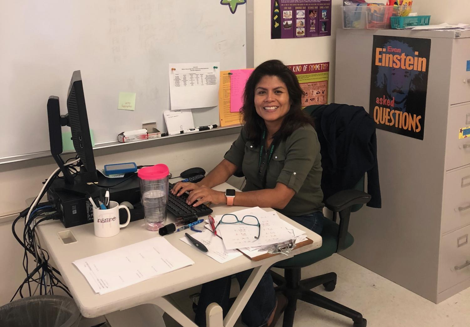 Olga (Lidia) Talavera, a new math teacher here at WJ, works at her computer while students complete a worksheet in her 3rd period Related Math class. Talavera is excited to be working at WJ this year.