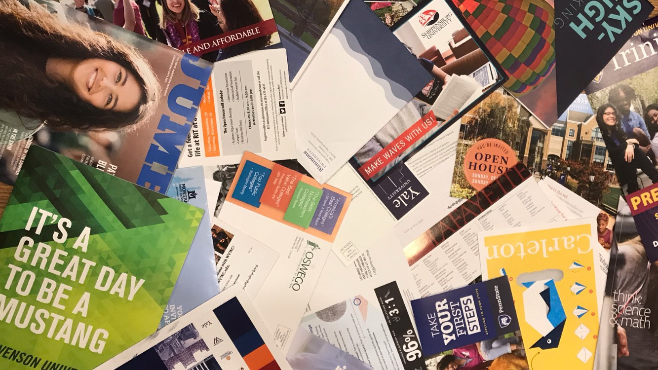 A multitude of letters come in through the mail each day, promoting different colleges to prospective students.