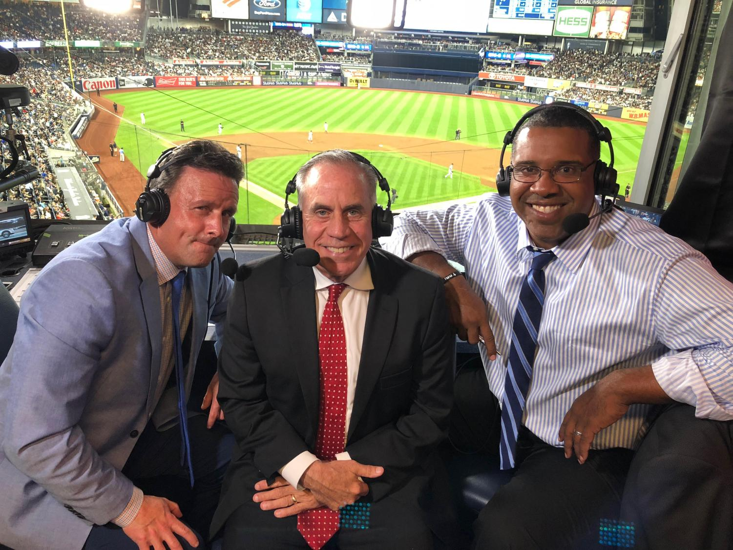 Kurkjian (center) called the September 19 Boston Red Sox vs. New York Yankees game on ESPN. Kurkjian, who graduated from WJ in 1974, has worked for ESPN since 1998.
