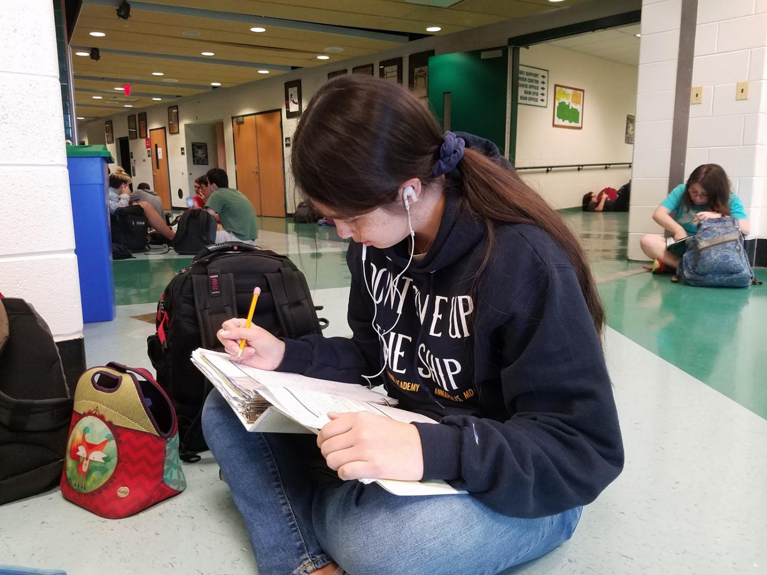 Sophomore Madison Mateo works on Spanish homework during lunch.  Lunch is a popular time for students to finish work that they were unable to finish at home.