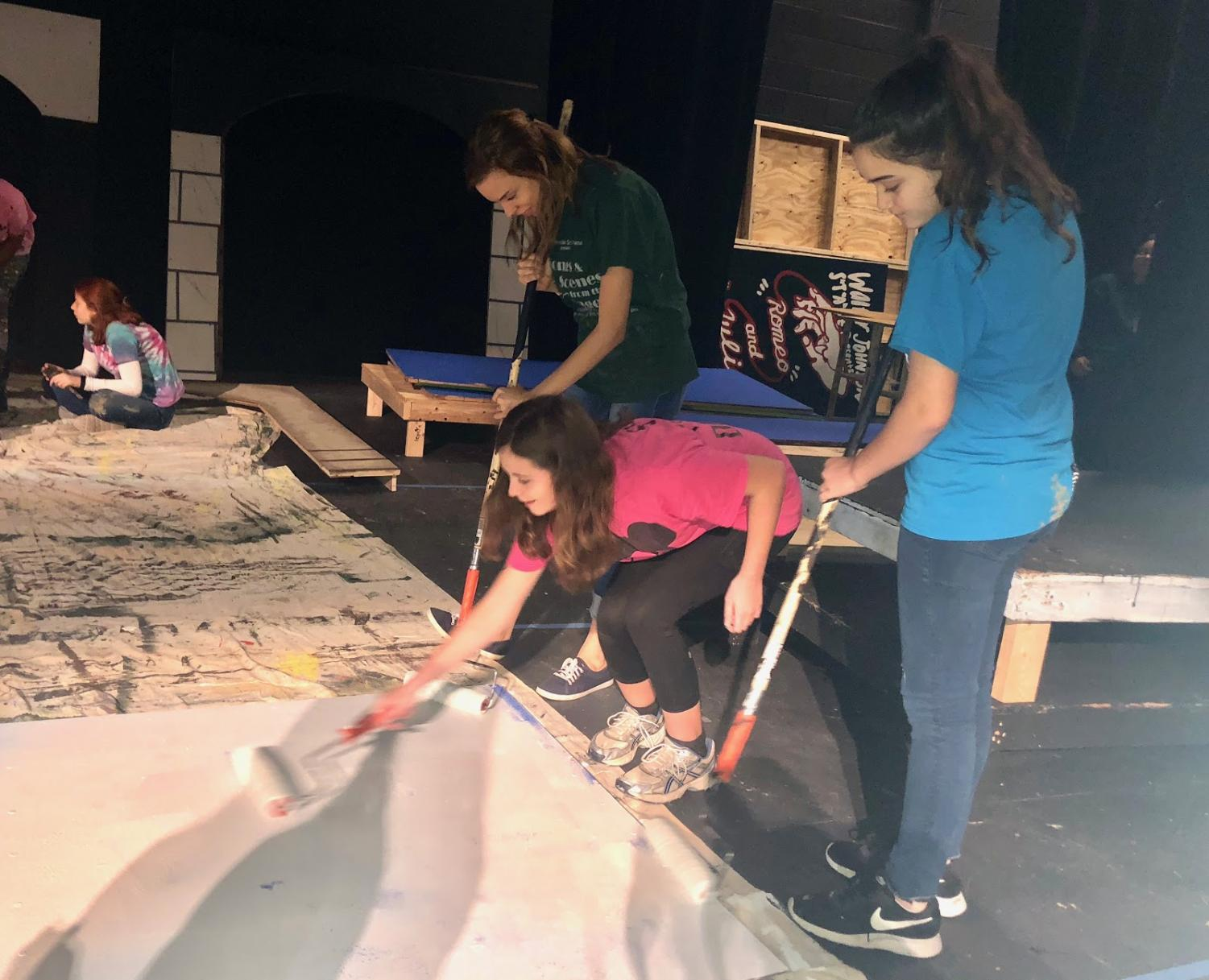 The Paint crew isn't afraid to get messy when it comes to making sure the sets look their best. Be sure to come watch the sets come to life in one of the four performances!