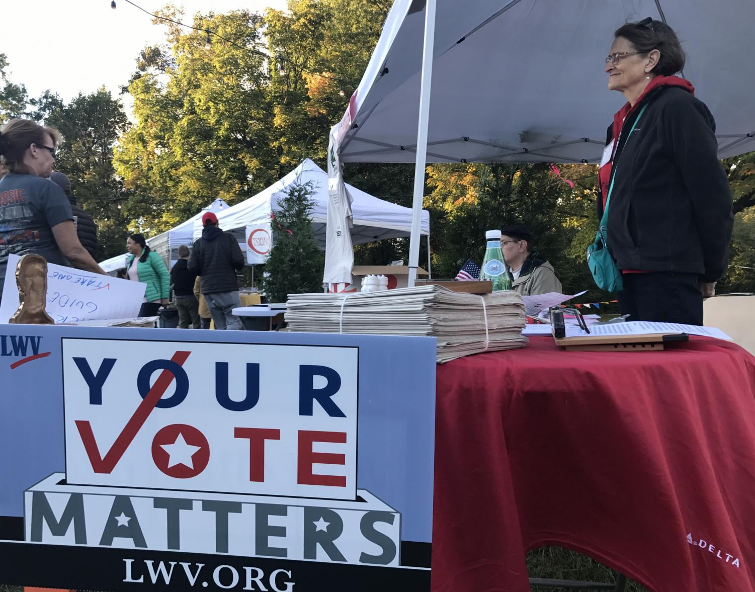 Volunteers set up a voter registration tent at a local festival. Political controversies have caused some formerly indifferent people, along with many newly 18 year old youths to sign up.