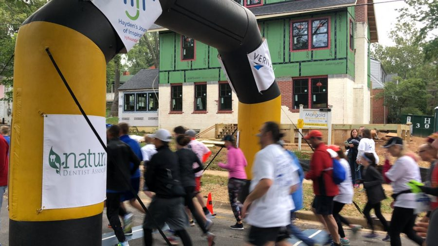 The runners of the 5k cross the starting point at the beginning of the race. This years turnout was the best the HJI foundation has had in all 10 years!
