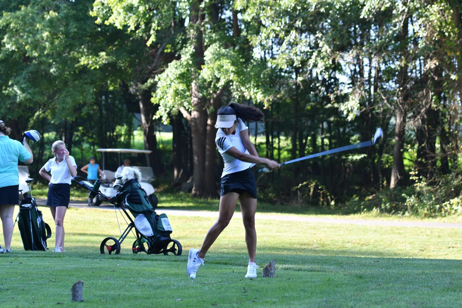Senior Sabrina Stecklein swings her club at a tee at a seasonal match. She received eighth place for her average in the total ladies district.