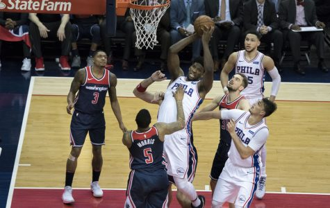 Philadelphia 76ers center Joel Embiid skies in for a rebound against the Washington Wizards. Embiid is a key player on what many expect to be a championship contending team this season.