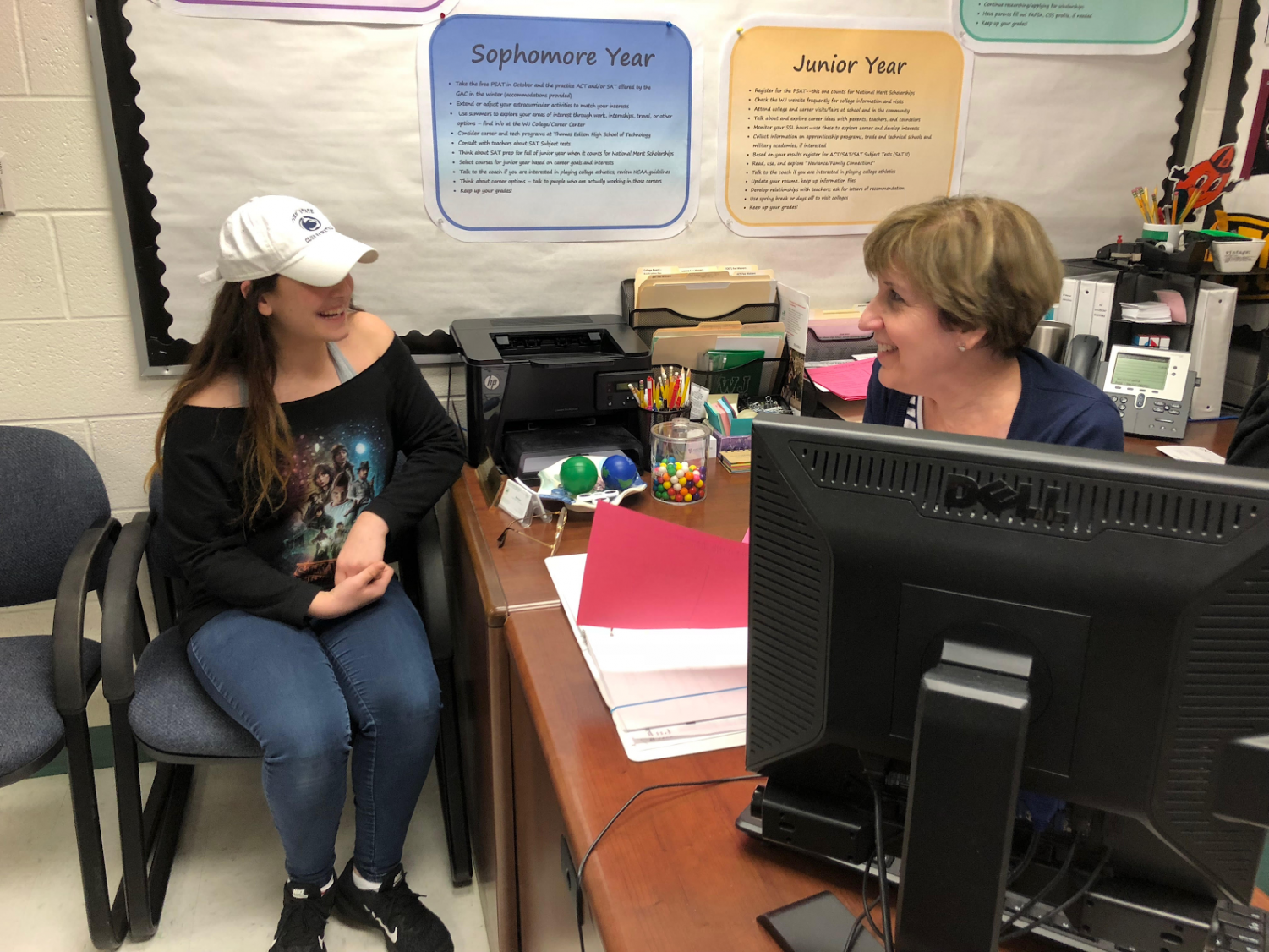 Sophomore Jordan Kelbert discusses future Penn State plans with college aid Gayle Evans. Evans has helped Kelbert, like many other students, with managing the college process and search as well as summer programs and jobs for seven years.