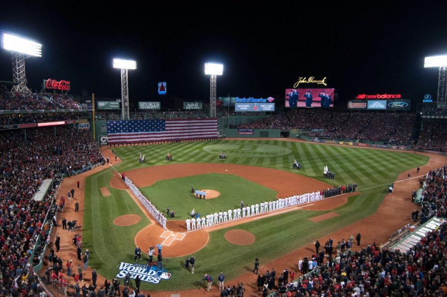 The+Red+Sox+and+Cardinals+lineup+prior+to++the+matchup.+The+stadium+atmosphere+at+this+World+Series+game+is+what+draws+many+fans+to+the+action+packed+postseason.+%0A%0A