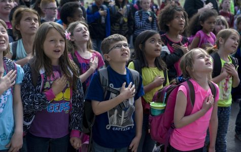 Elementary school students stand for the Pledge. Many WJ students did the same when they were in Elementary school, but most don't stand anymore.