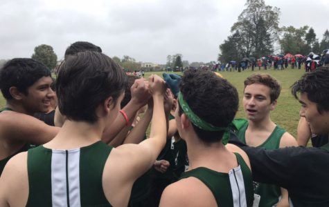 Boys cross country prepares for the county championship with a pre-race pep talk. The boys ended up in fifth place behind Northwood, Paint Branch, Wotton and Whitman on the cold rainy day.