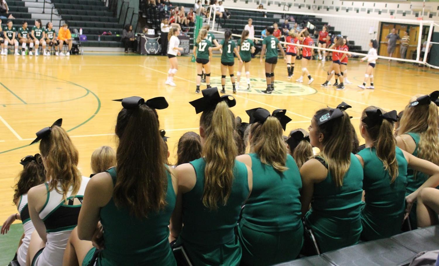 Varsity and JV cheerleading teams attend the girls varsity volleyball game, and cheer them on during their win over Wootton.  In the fall, cheer primarily attended football games, and not many other sports, due to their busy schedule.