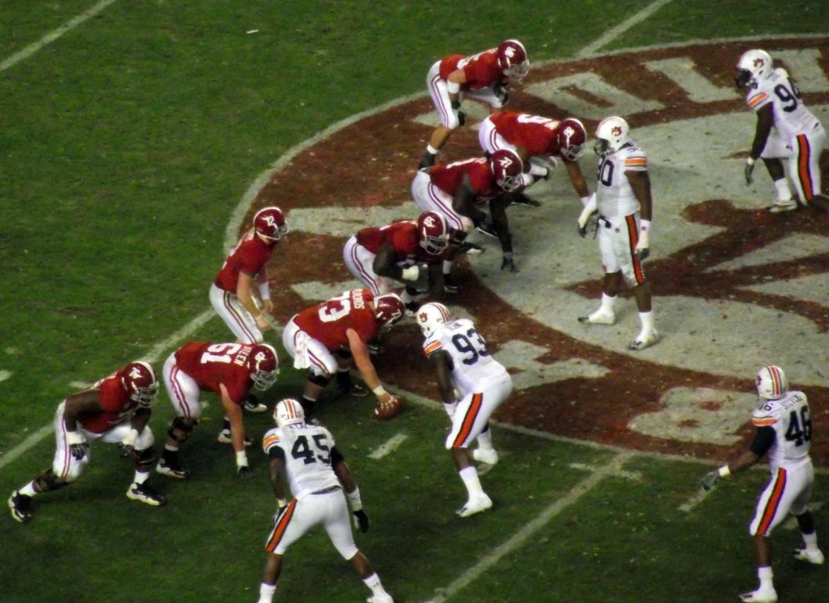 Alabama lines up for a crucial play against Auburn. This year they got past the Tigers with ease and look to continue success in the College Football Playoff.