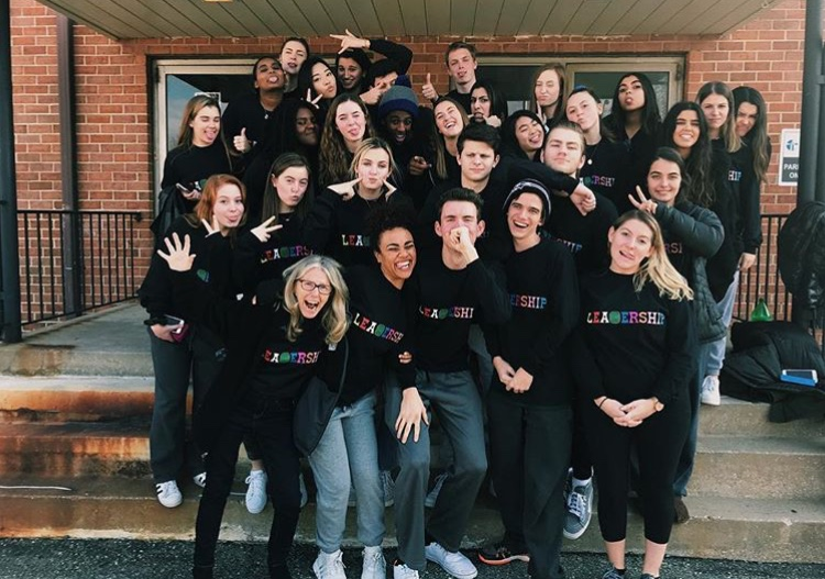 """Leadership students pose outside of the Rockville escape room in their new """"Astroworld"""" themed shirts Students enjoyed the escape room and saw a it as a great break from school during the school year."""