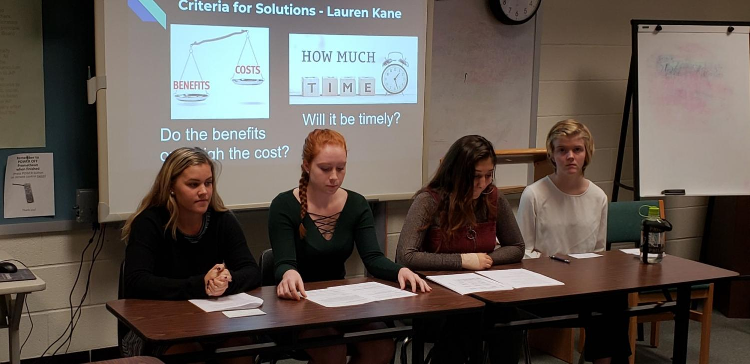 Seniors Polly Litts, Lauren Kane, Keren Peter and Mel Mader present a comprehensive research project on bell times at schools. The classes took part in multiple projects of similar nature throughout the semester.
