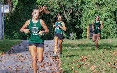 Senior Adrienne Bruch competes in a race. Bruch has proved to be a great leader on the team. Photo credit to Lifetouch.