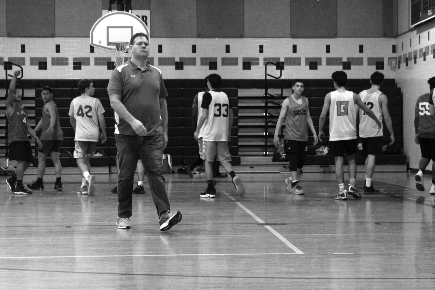 New basketball head coach Kevin Parrish runs drills during a practice. Parrish looks to build on last season's five victories heading into this season.