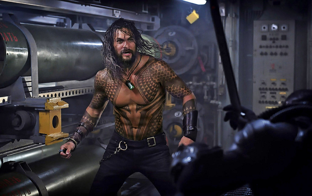 Jason Momoa's Arthur Curry (Aquaman) fighting Black Manta aboard a submarine. The beginning of the film kicks off with Aquaman intervening in an attempted submarine takeover by Black Manta's crew.