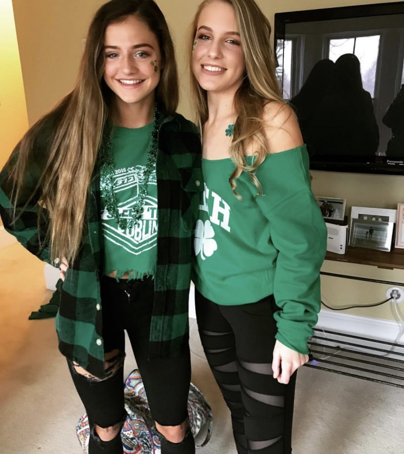 Juniors+Ally+Hilligoss+and+Brooke+Haines+sport+their+St.+Patrick%E2%80%99s+Day+spirit+with+four+leaf+clover+stickers%2C+green+necklaces+and+green+clothing.+The+girls+showed+up+to+ShamrockFest+with+a+big+group+of+friends+and+plan+to+attend+the+event+this+year+as+well.%0A