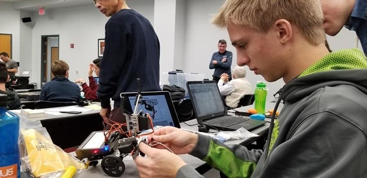 WJ students practice building robots at one of the club's meetings. The Robotics Club meets every week to prepare for the BotBall Robotics Competition and teach participants about programming and engineering.